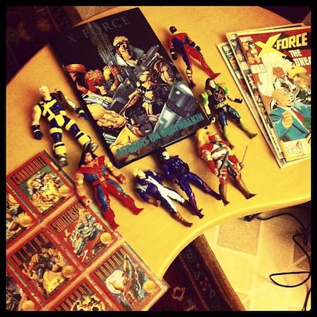 Photograph of X-Force comic books and action figures