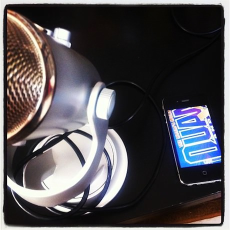 Still life photograph of a microphone and an iPhone.