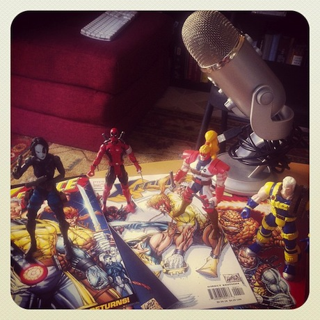 Still life photograph of a microphone and the X-Force action figures.