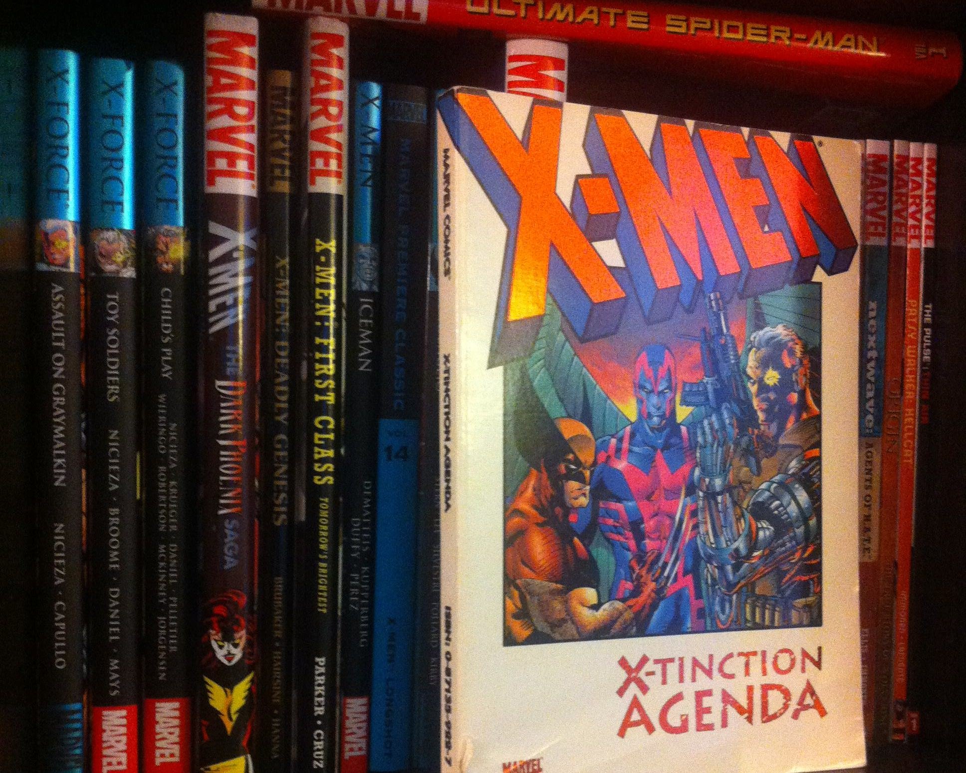 X-Tinction Agenda on a bookshelf